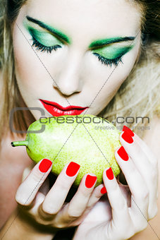 Woman portrait smelling a pear