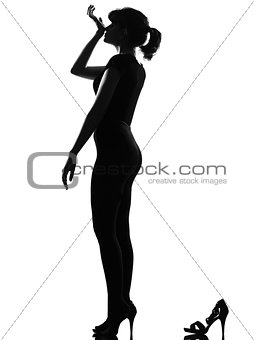 silhouette woman smelling perfume