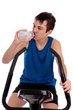 Teenager using exercise bike fitness gym