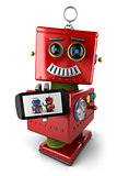 Vintage toy robot with smartphone