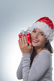 Beautiful woman in a red santa hat