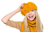 Happy girl in scarf and hat having fun