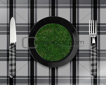 green grass on black plate