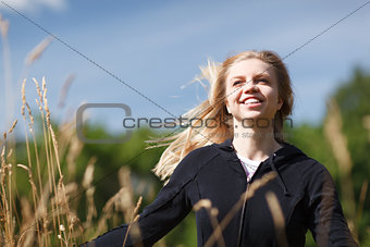 Young and happy girl in the field