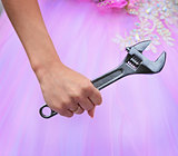 Hand of bride holding a big wrench
