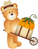 Teddy bear carrying pumpkin in wooden cart
