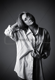 Studio shot of seductive young girl wearing white shirt.