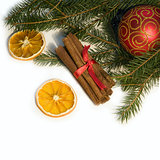Christmas red ball, twig of fir, orange and  cinnamon