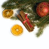 Christmas red ball, twig of fir, orange and  cinnamon