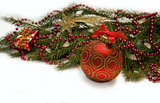 Christmas red ball, twig of fir , beads