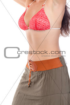 Slim waist of a beautiful young woman in beach dress