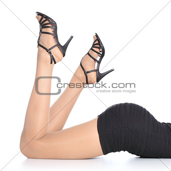 Beautiful woman legs with stockings and heels pointing up