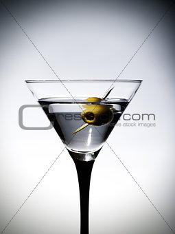 One martinis glass with olive