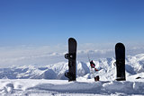 Three snowboards in snow near off-piste slope in sun day