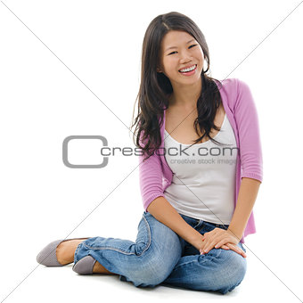 Asian female sitting on floor