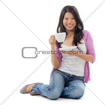 Asian female drinking tea