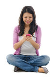 Young Woman texting on smart phone
