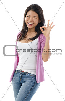 Asian woman showing okay hand sign