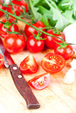 fresh tomatoes, rucola, garlic and old knife