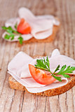 bread with sliced ham, fresh tomatoes and parsley