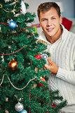 Man by Christmas tree