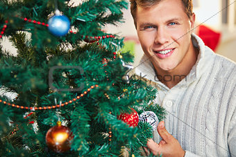 Man by decorated tree