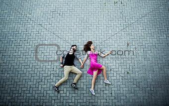 Lying on pavement