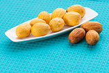 Nuts on a white saucer and near it