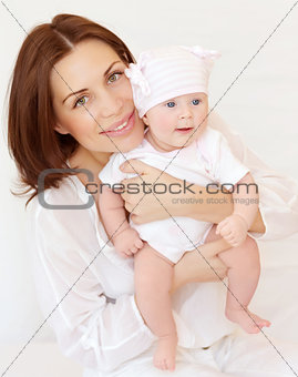 Beautiful woman with newborn daughter