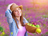 Pretty woman with apples basket