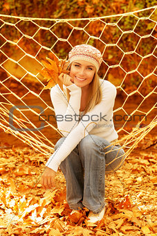 Woman sitting in hammock