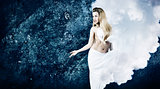 Blonde Woman in Cloud Dress at Grunge Blue Wall
