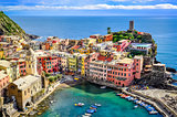 Scenic view of ocean and harbor in colorful village Vernazza, Ci