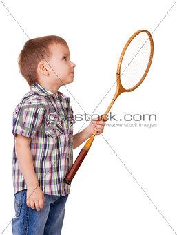 Boy with badminton racket on white