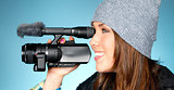 Hip Young Adult Female Points Video Camera Blue Background