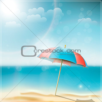 Summer day on ocean beach with umbrella