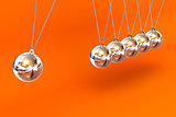 Newtons Cradle on a Orange Background