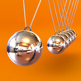 Newtons Cradle against an Orange Background