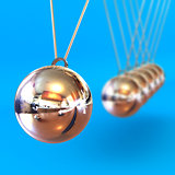 Newtons Cradle against a Blue Background