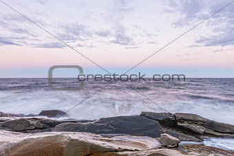 Waves crashing the ocean shore at crack of dawn (Slow shutter sp