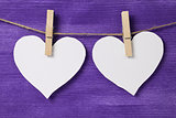 two paper hearts hanging on rope