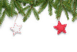 border from fir twigs with stars