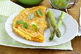 fresh egg omelet with asparagus and basil