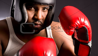 Tough African American Male Ready to Box Man Red Boxing Gloves