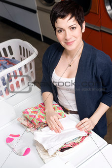 Attractive Happy Housewife Female Folding Laundry Traditional Woman