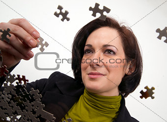 Business Woman Working a Jigsaw Puzzle
