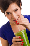 Pretty Brunette Woman sips Blended Green Wheat Grass Smoothie