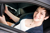 Driver Attractive Female Drives New Fast Car