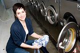 Laundry Day Pretty Brunette Woman Empties Dryer Laundromat
