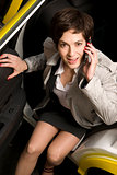 Business Woman Talking on Cell Phone Exits Taxi Cab